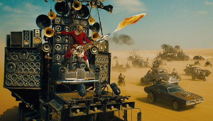 The reveal of a man in a bright red jumpsuit on a speeding car playing a double-necked electric guitar that is also a flamethrower made the price of admission worth it.