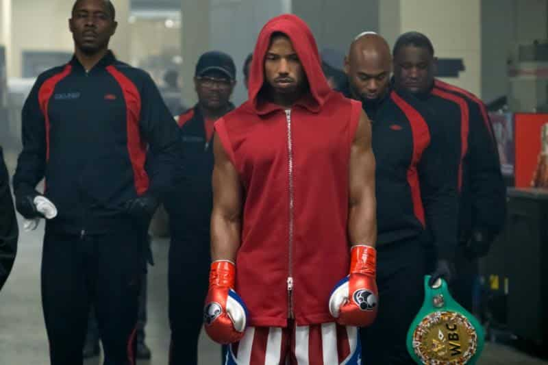 (left) Wood Harris stars as Tony 'Little Duke' Burton and (ctr) Michael B. Jordan as Adonis Creed in CREED 2